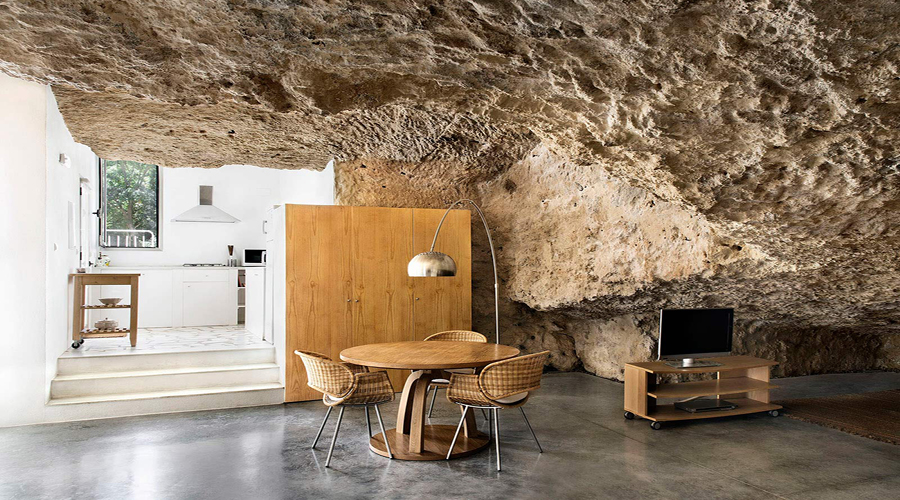 Explore this Spanish home built into the foothills of a ...