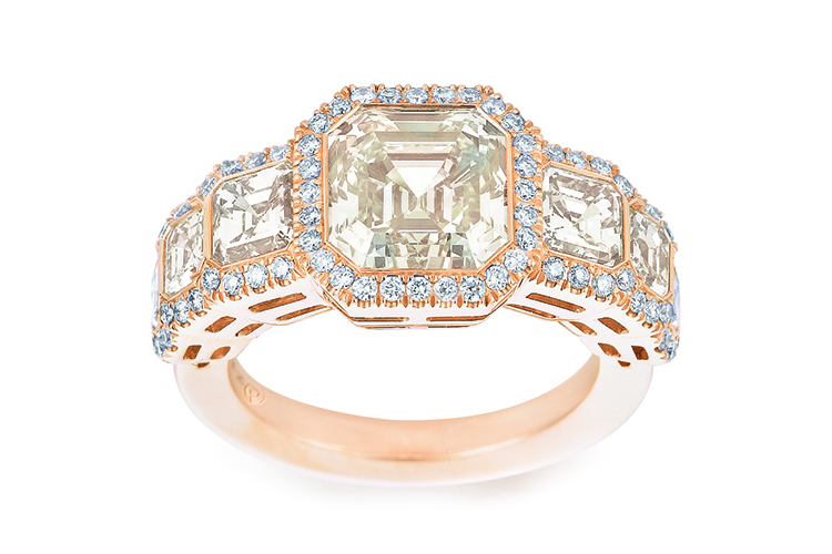Hints of yellow asscher ring with off-white diamonds
