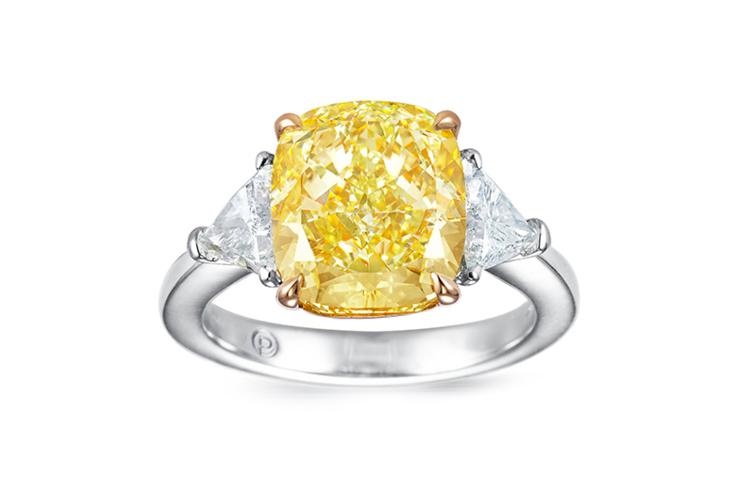 Cushion cut yellow diamond and half-moon white diamond ring