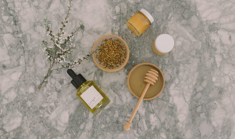 This honey-based hair oil is finally bringing life back to our sun-damaged locks