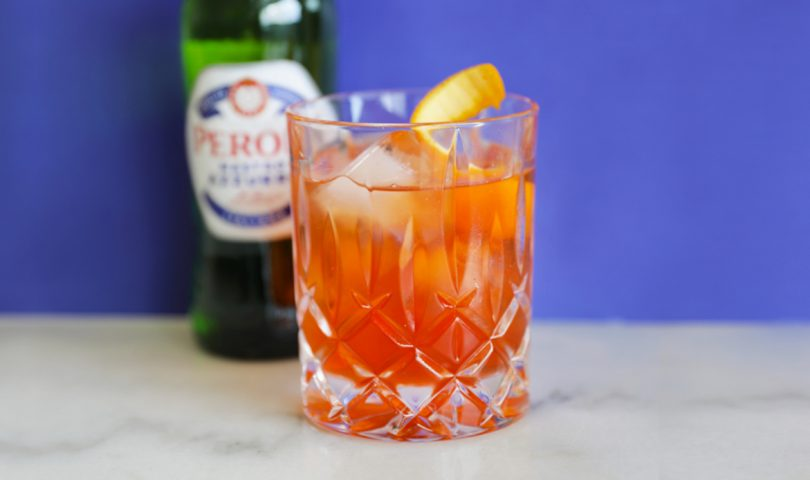 How to elevate the classic Negroni with a drop of Peroni's premium, crisp lager