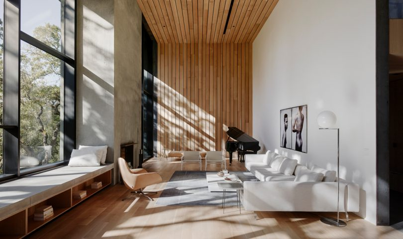 This light-filled home champions eco-conscious design, harmoniously embracing its surroundings
