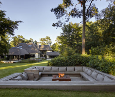 Nestled in a private wooded enclave, this spectacular home has far more to it than meets the eye